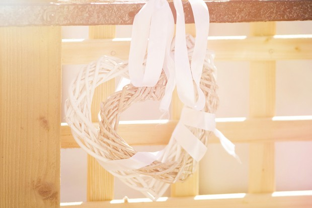 White wooden heart with ribbons