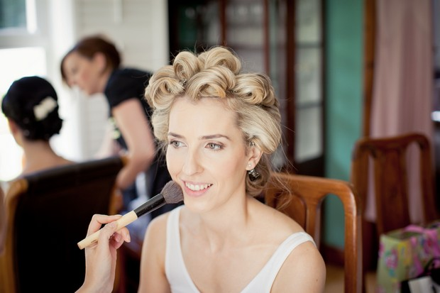 bride with hair in rollers