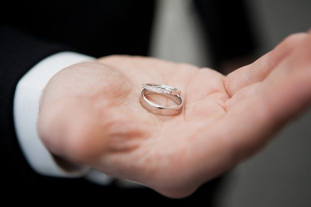 matching wedding rings in hand