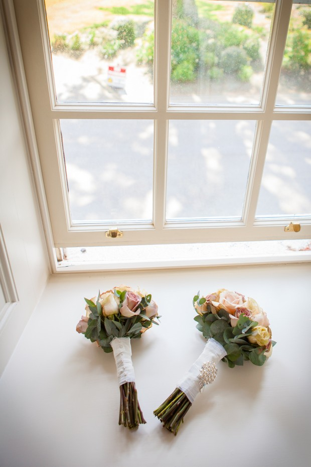 soft pink wedding bouquets in window