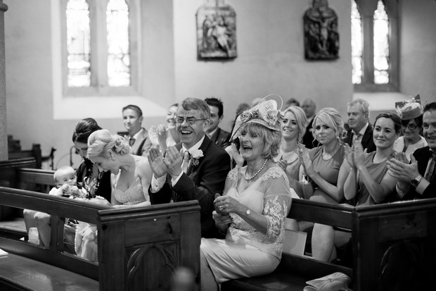 guests-laughing-church-wedding