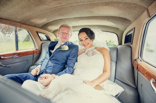 bride-father-in-car-holding-hands