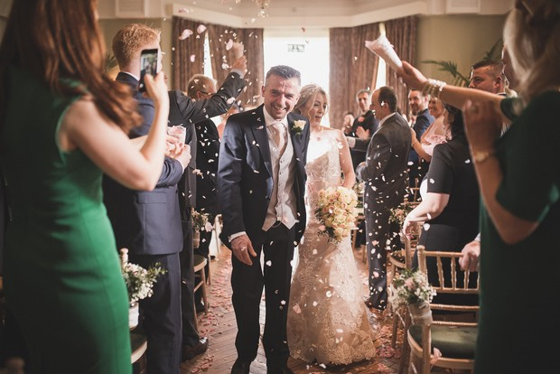 guest-throw-confetti-couple-coming-down-aisle-ceremony (2)