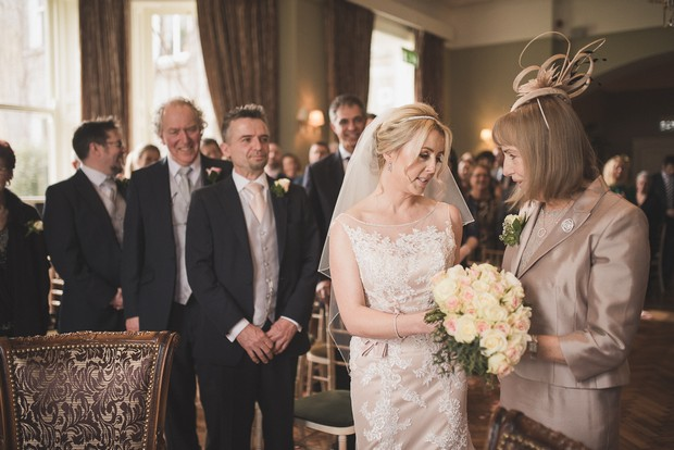 mother-walking-daughter-up-aisle-giving-away-bride (1)