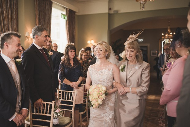 mother-walking-daughter-up-aisle-giving-away-bride (3)