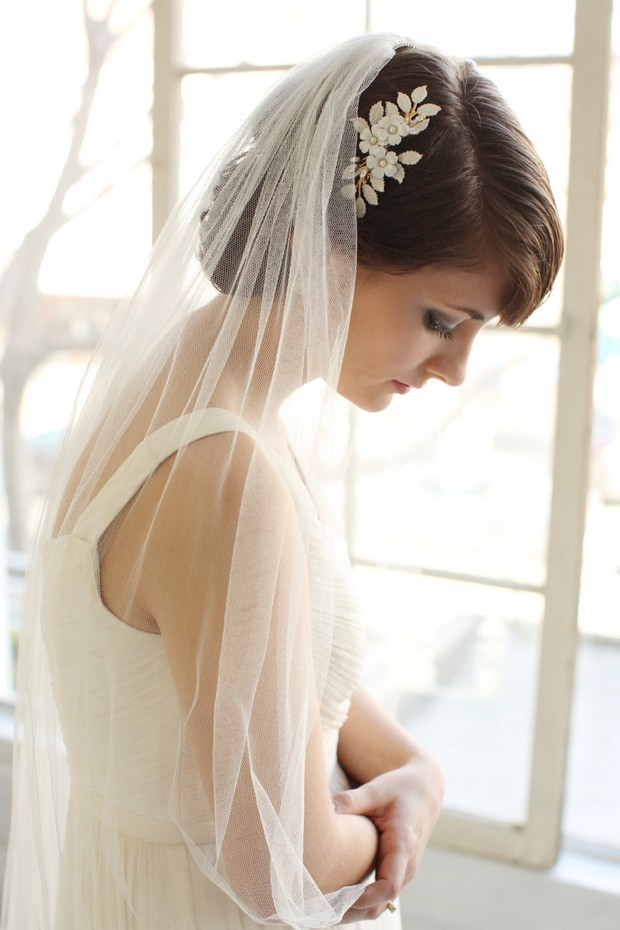bride-with-veil-and-floral-hairpiece