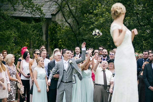 groom-catching-bouquet-toss-funny-photos