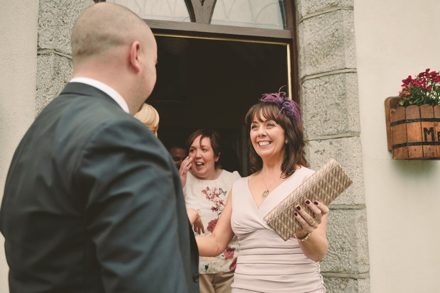 12-greeting-wedding-guests-after-ceremony
