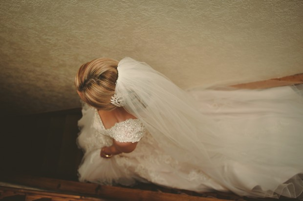 8_dreamy-wedding-photography-bride-walking-down-stairs