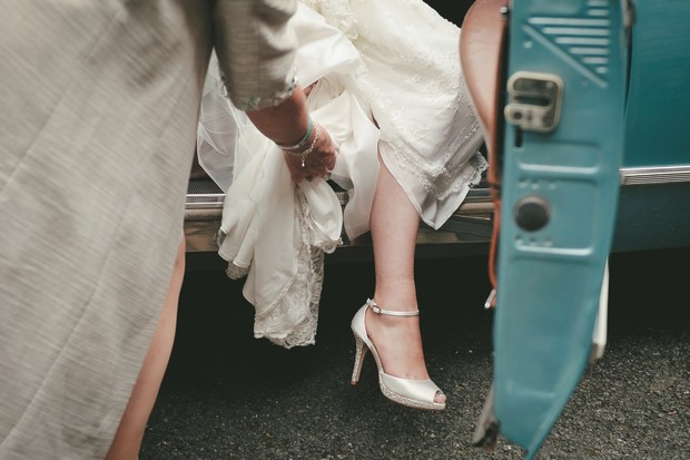 17_Bride_stepping_out_of_vintage_blue_wedding_Car
