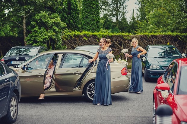 23-Bridesmaids-getting-out-of-cars-church