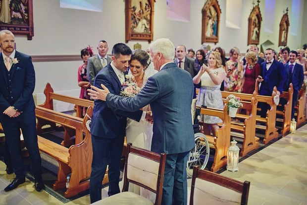 30-father-shaking-grooms-hand-giving-daughter-away