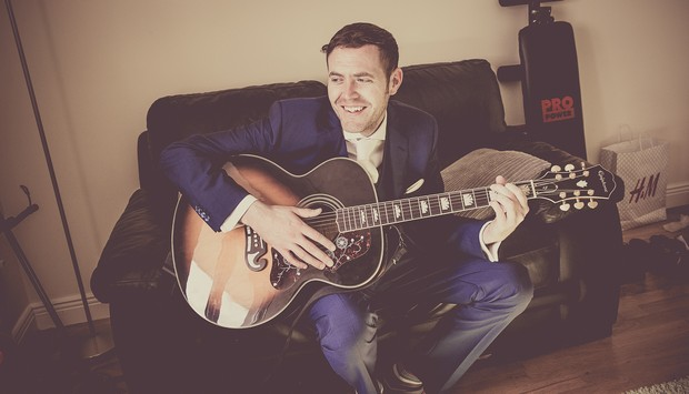 4_groom_playing_acoustic_guitar