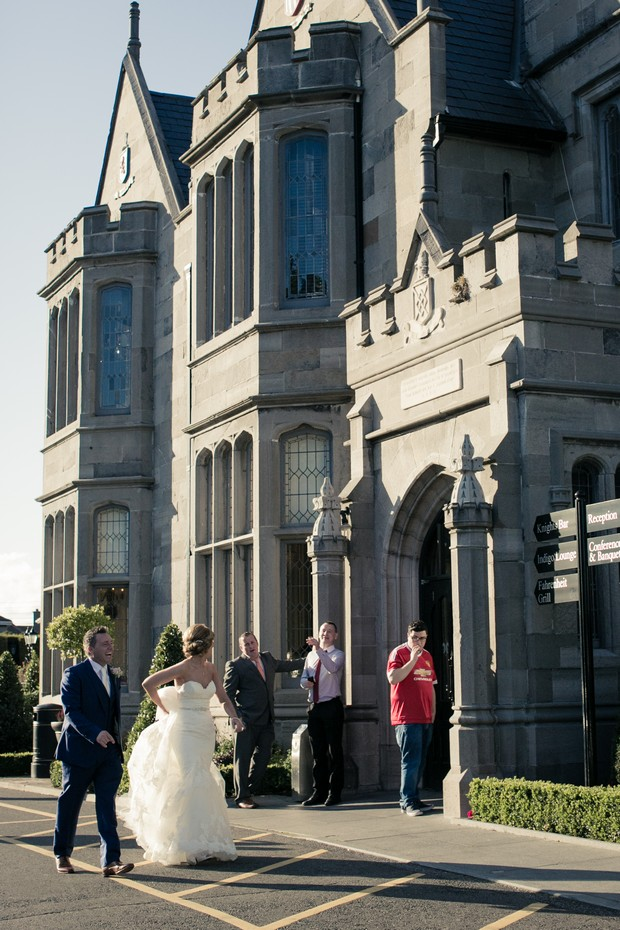 bride-and-groom-chatting-to-wedding-guests-outside-clontarf-castle