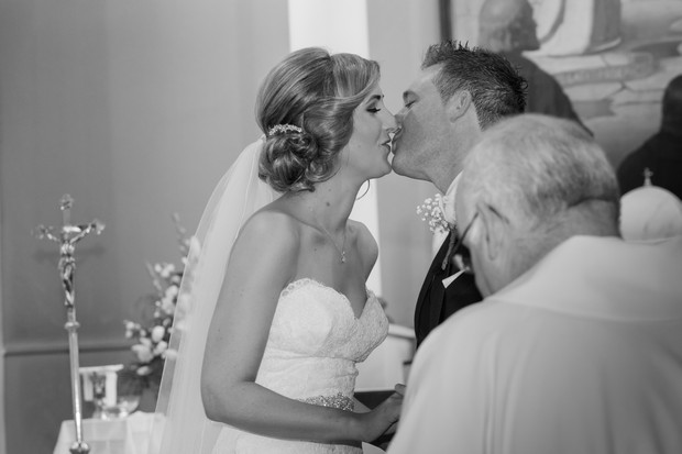 bride-and-groom-kissing-ceremony