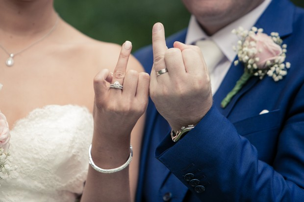 bride-and-groom-showing-off-wedding-rings-clontarf-castle-real-wedding