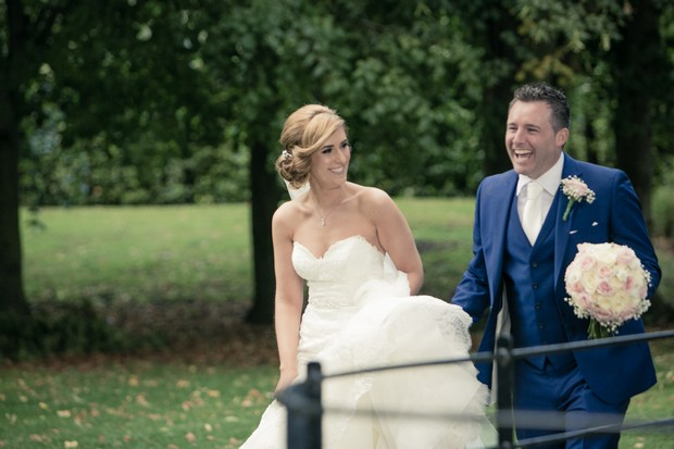 bride-and-groom-walking-around-grounds-of-clontarf-castle
