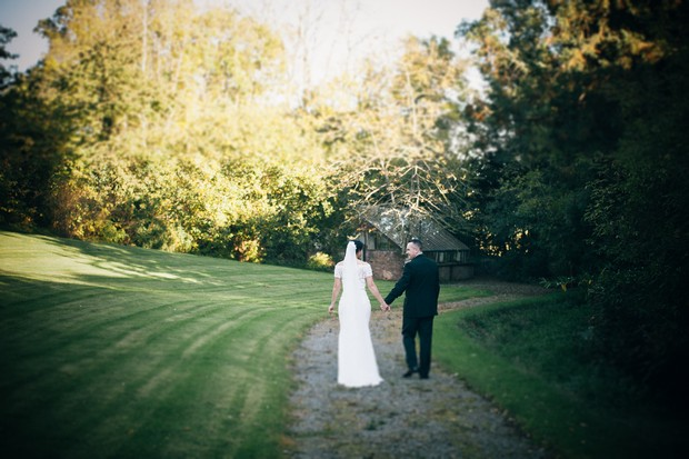 bride-and-groom-walking-boyne-hill-house-wedding