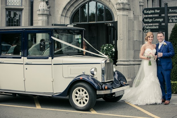 bride-and-groom-with-vintage-car-outsode-clontarf-castle