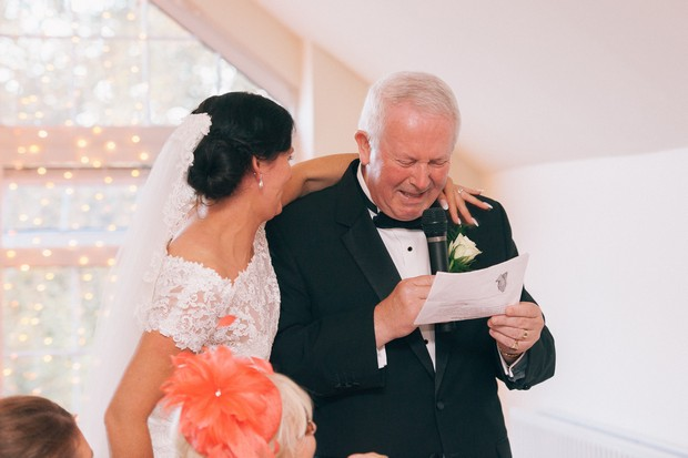 bride-hugging-father-during-father-of-the-bride-speech