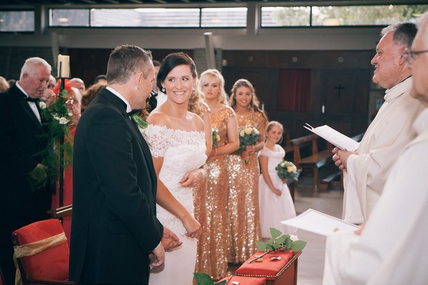 bride-smiling-at-groom-wedding-ceremony