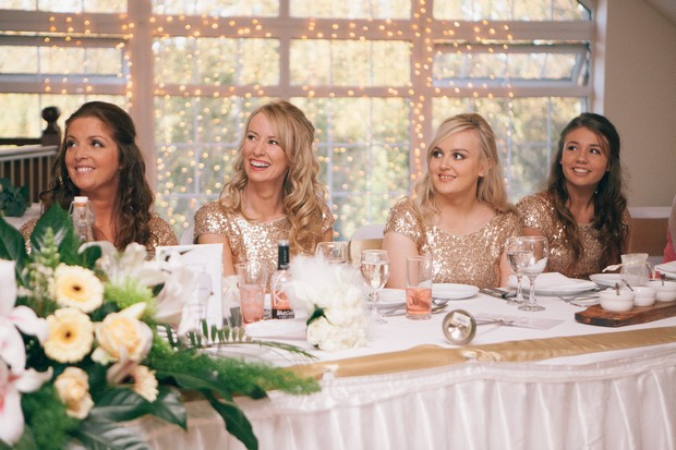 bridesmaids-at-top-table-listening-to-wedding-speeches