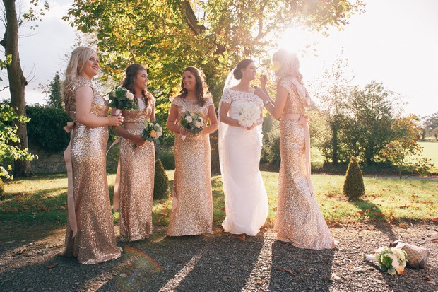 bridesmaids-in-gold-glittery-full-length-dresses