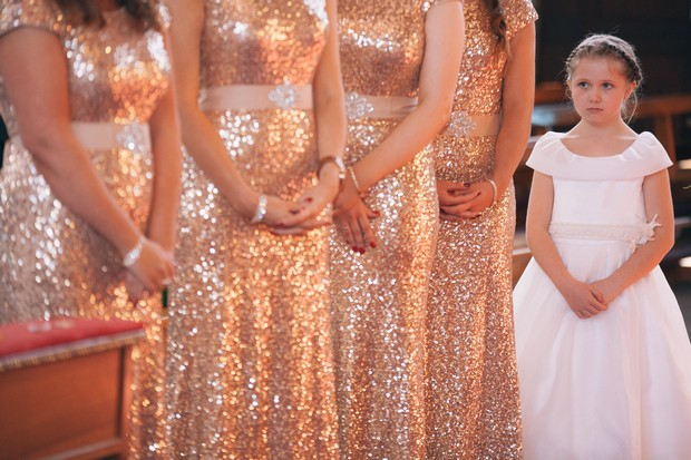 bridesmids-in-gold-glittery-bridesmaid-dresses-flower-girl-in-ivory-dresss