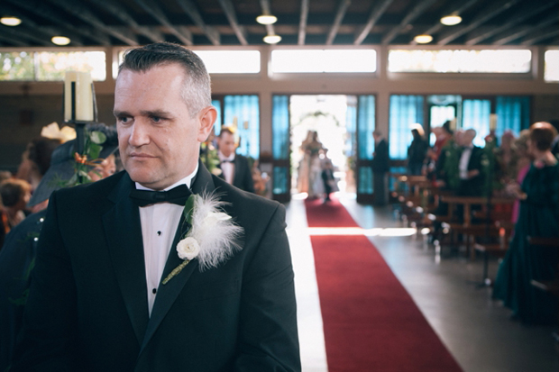 groom-waiting-at-the-top-of-the-aisle