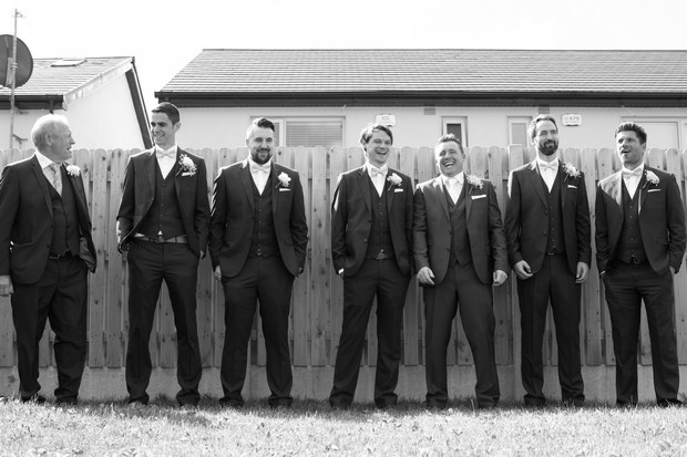 groomsmen-in-traditional-three-piece-suits