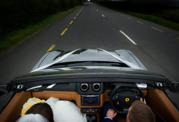 15-Bride-Groom-Driving-Getaway-Car-Convertible