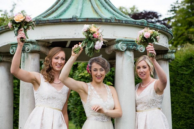 anglers-rest-real-wedding-julie-photo-art-bride-and-bridesmaids-waving-bouquets
