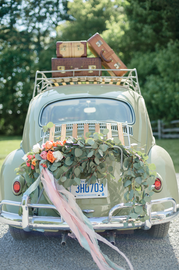 wedding-getaway-car-with-ribbon-streamers-and-floral-garland