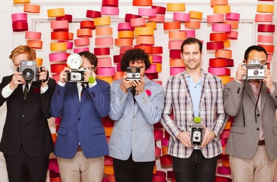 wedding-photo-booth-backdrop-ideas-colourful-paper-hangers
