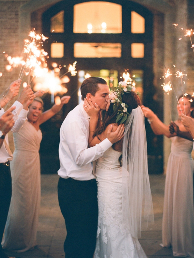 bride-and-groom-kissing-surrounded-by-sparklers