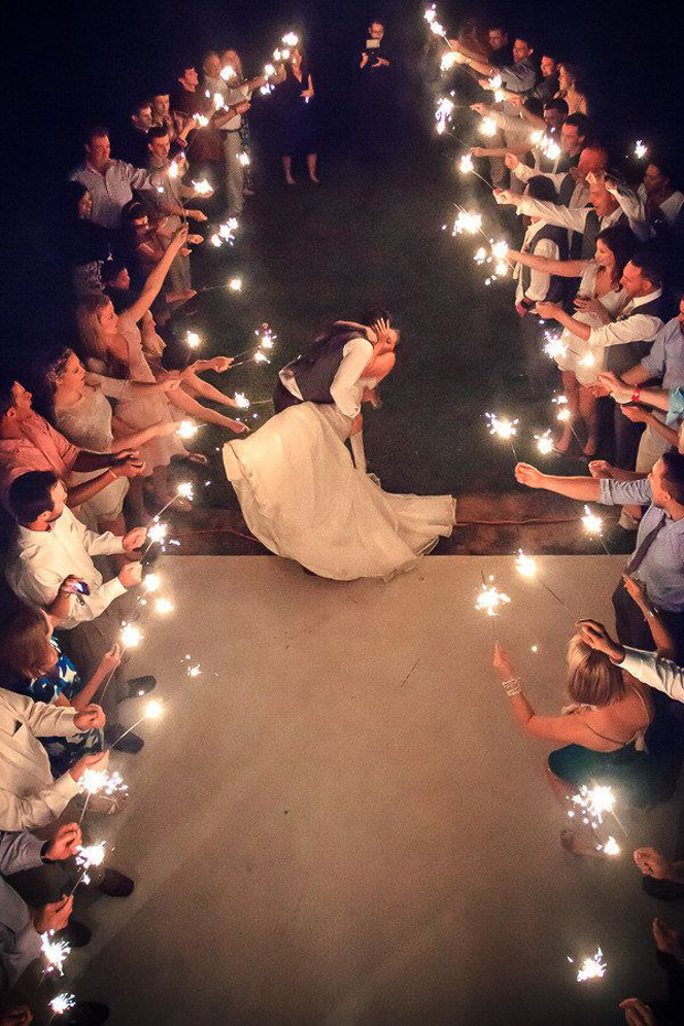 first-dance-couple-surrounded-by-sparklers-wedding