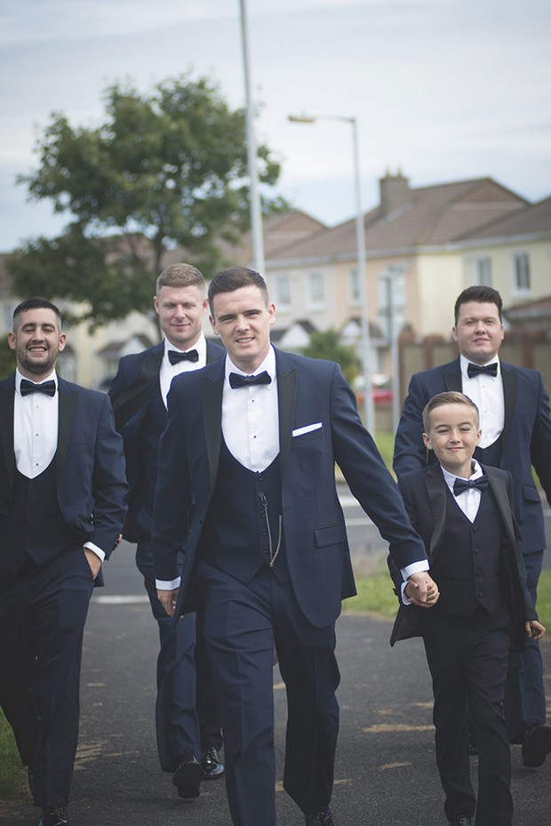 groom-and-groomsmen-walking-to-ceremony