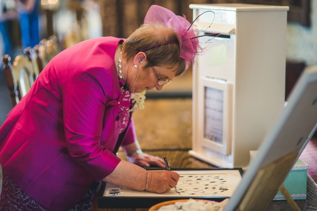 barberstown-castle-wedding-guest-signing-guest-book