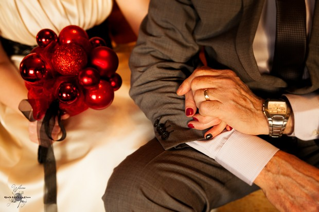 bride-with-bauble-bouquet-holding-groom's-hand