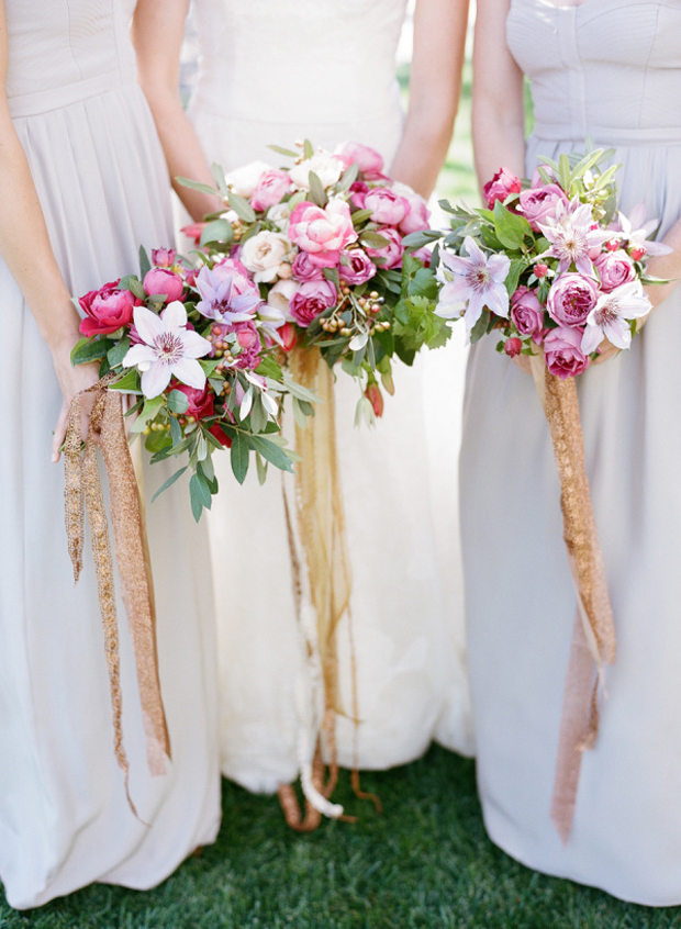 bridesmaids-with-bouquets-with-gold-sparkly-ribbon