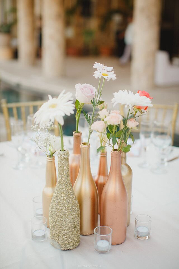 spray-painted-and-glittery-bottles-wedding-decor