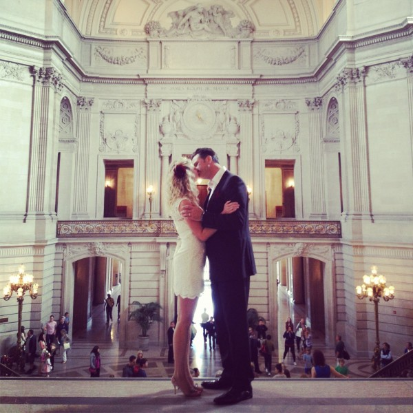 bride and groom kissing instagram picture