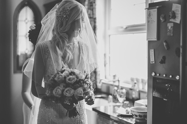 Bride wearing veil, ready to go
