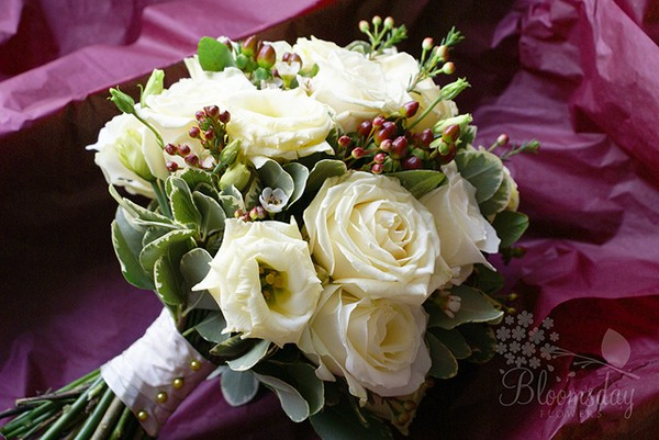 Traditional ivory winter bouquet with berries