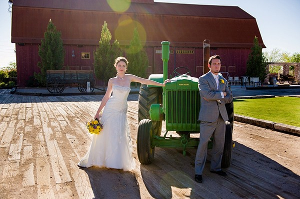 Posing with the farm machinery