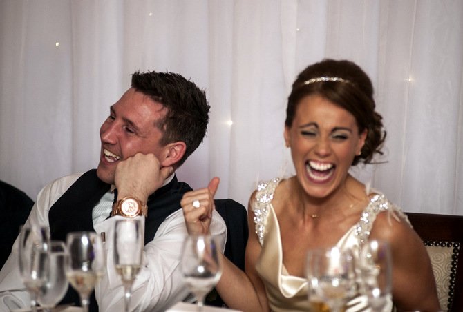 bride laughing at top table