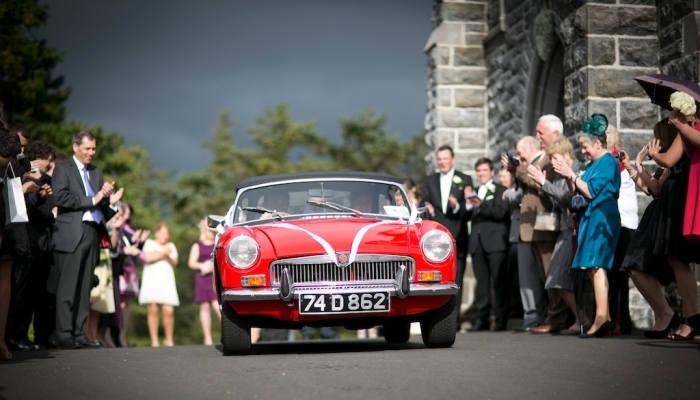 red vintage wedding car