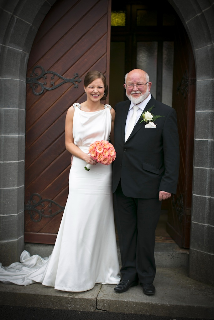 bride and father of the bride at church