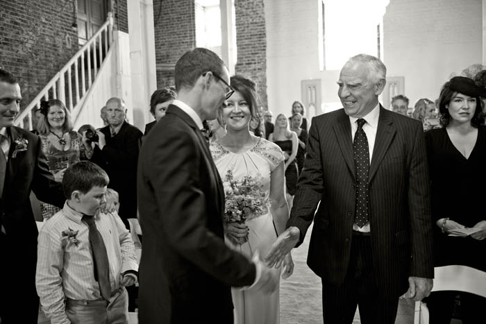 father of the bride shaking hands with groom