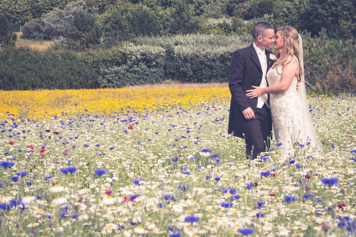 bride and groom in a field of flowers, Fenit, Tara Donoghue Photography